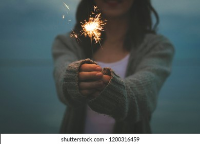 Women with sparklers in their hands