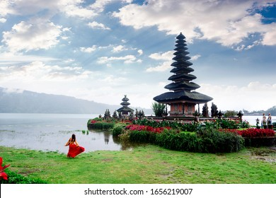 Women spending time at the Ulun Datu Bratan temple in Bali. Concept about exotic lifestyle wanderlust traveling,