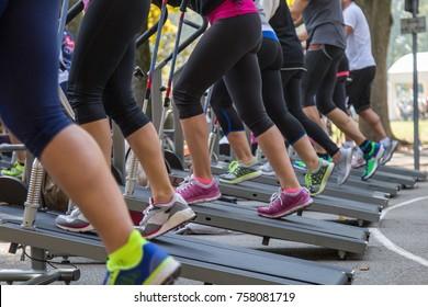 Women in Sportswear Exercising Outdoor on Treadmills.