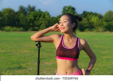 Women in sportswear Photo poses with tripod