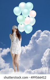 Women stand on the cloud holding balloons (surreal retouching style)