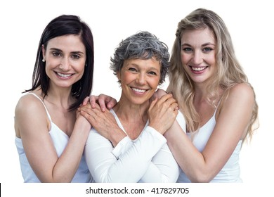 Women standing and holding hands on isolated white background
