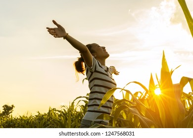 women standing a outdoor with sunset light in countryside for relaxing in field