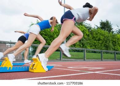 Women starting the race in the stadium