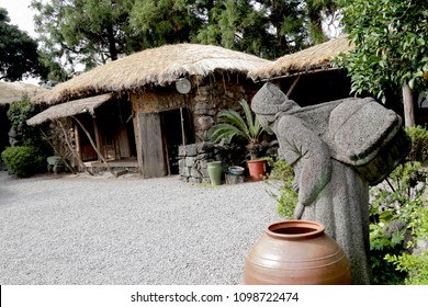 Women stone statue in Korean traditional house at Seongeup Folk Village in Jeju Island, South Korea.