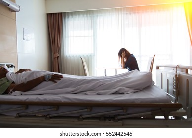 Women strain and worried for her friend in bed health condition in hospital room, select focus