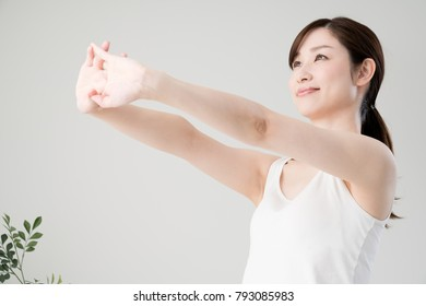 Women stretching, arms, shoulders