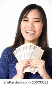 women success holding money in her hands