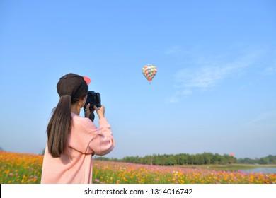 Women take photo of balloon