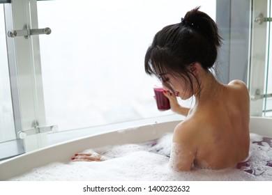 Women taking a bath at home