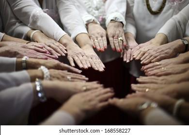 Women team put all hands together