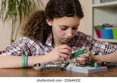 Women and technology: Teenage girl working on an electronics project