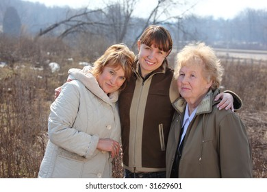 Women of three generations of one family, spring outdoor
