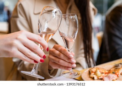 Women toasting with rose wine in restaurant