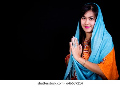 Women with Tosca Blue Veil with black background  crossing her hand on the right