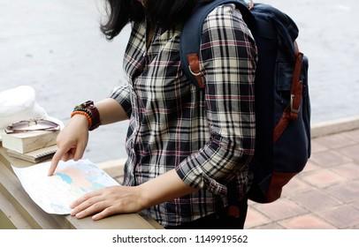 Women tour Viewing travel maps using a navigation map.