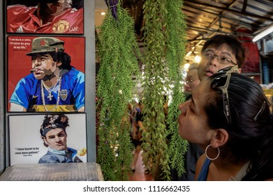 Women tourists are looking at the world famous football player.Diego Maradona weekend market Bangkok 14  March 2017