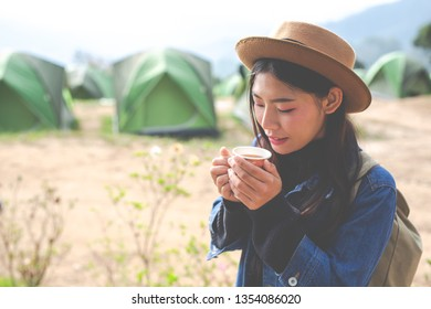 Women tourists are sipping coffee in the morning.