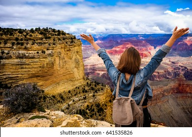 Women tourists wear jacket jeans at sunny light and blue sky at Grand Canyon  National Park , Arizona, USA