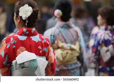 Women in traditional clothes of Kimono on a street in Tokyo, Japan.