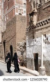 Women in traditional dress on the streets of Sanaa. Sanaa, Yemen, July 29, 2010.