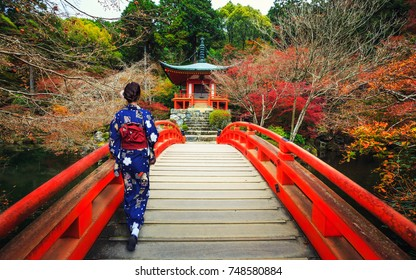 Women in traditional japanese kimono walking on bridge in the autumn season,The leave change at Daigo-ji temple with colorful maple trees