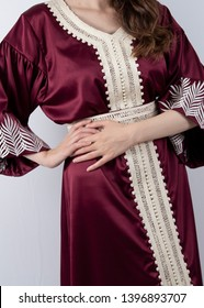 Women in Traditional Moroccan Kaftan Dress