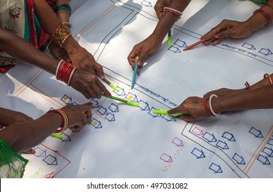 Women are trained in mapping their own village to apply for infrastructure support from the Indian government, Jharkhand, India