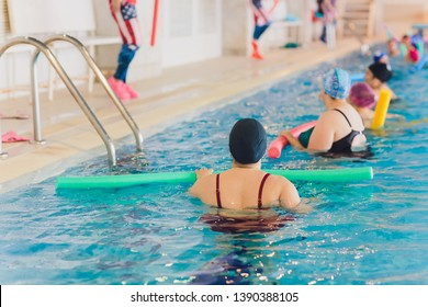 women trains in aqua aerobics, learn to swim.