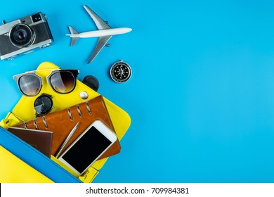 Women travel equipment object coming out of a purse