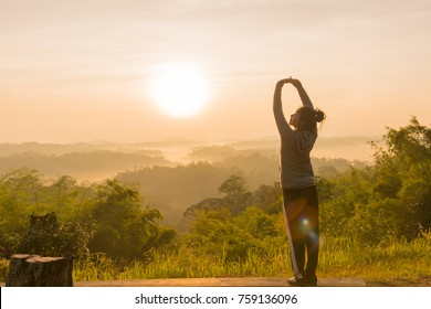 women Travel nature in the mountains,Woman watching the sunrise.