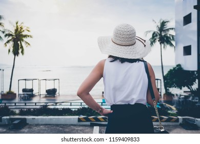 Women travel to the sea during the summer.
