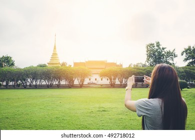 Women travelers are shooting in the temple of Nan,Thailand. Vintage tone