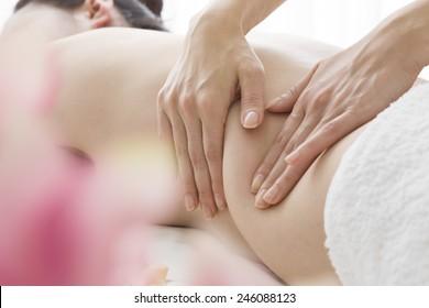 Women undergoing belly massage