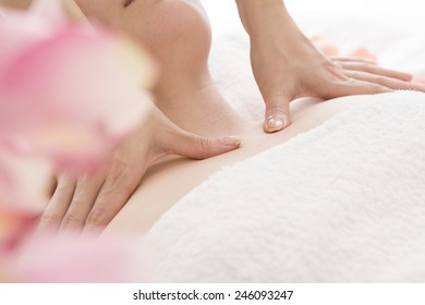 Women undergoing oil massage