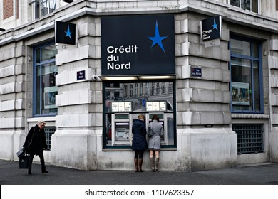 Women use the ATM in Credit du Nord branch in Lille, France on Nov. 19, 2016