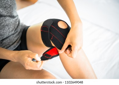 Women use knee supporter to prevent injuries.