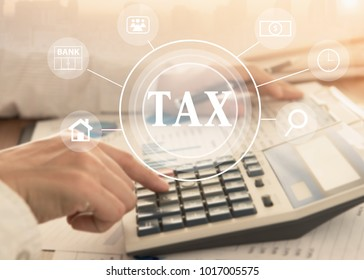 women using calculator calculated individual income tax for pay taxes annual.