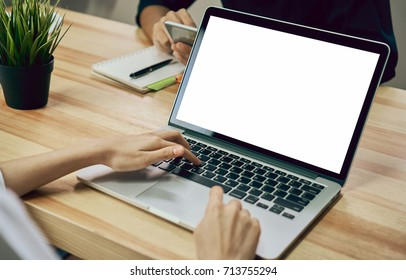Women using a laptop on white screen. Take your screen to put on advertising.