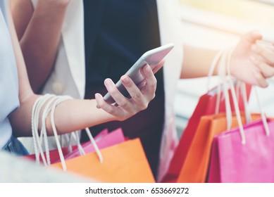 Women using smart phone online shopping,online shopping,social media concept.