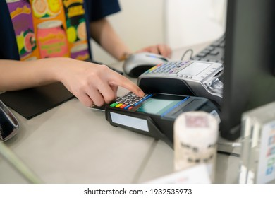 Women using Terminal Credit Card Machine , credit card payment without cash concept ,