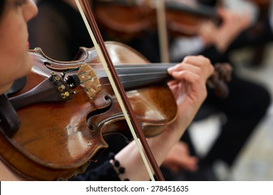 Women Violinist Playing Classical Violin Music in Musical Performance