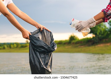 Women volunteer help garbage collection for to recycling and the campaign to stop using plastic to reduce global warming.