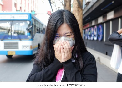 Women wait bus station wearing protective mask n95 suffering air pollution on street, Air pollution in city