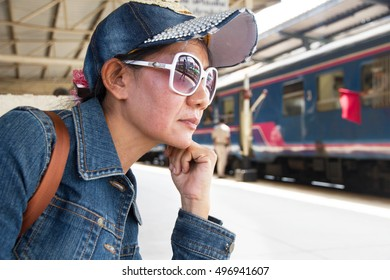 Women waiting my love his at train station alone