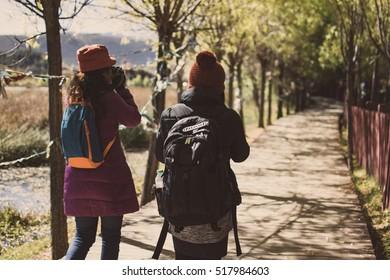 women walk on walkway with happiness