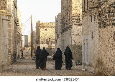 Women walking on a street of a village in Yemen
