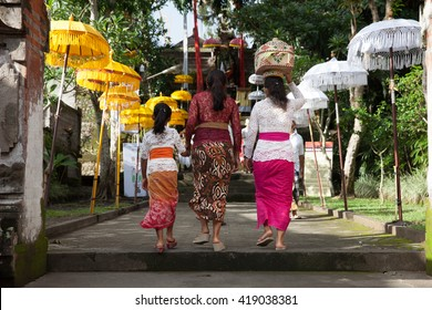 Women walks up the stairs during the celebration before Nyepi (Balinese Day of Silence) in Ubud, Indonesia.