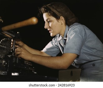 Women war worker finishing airplane parts in a hand mill at Consolidated Aircraft Corporation in Fort Worth, Texas. October 1942.