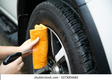 Women washing car wheels and truck wheels, coatings for refrigerant. Use a orange microfibre cloth. And upholstery